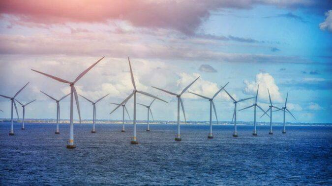 A field of windmills in the open ocean